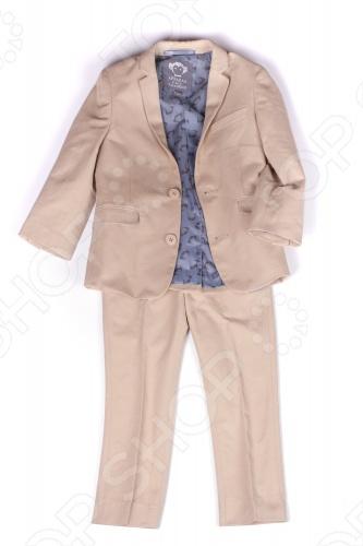 Костюм классический Appaman Suit Set это комплект для юного джентльмена. Великолепный костюм в английском стиле отличается изящным пошивом и прекрасным качеством ткани. Костюм состоит из пиджака и брюк. Брюки имеют эластичный пояс со шлевками и застежку с молнией и пуговицей. Благодаря внутренней резинке ширина талии легко регулируется. Пиджак пошит так же тщательно, как взрослые модели: есть застежка на пуговицах и декоративные пуговички на рукавах, нагрудный кармашек и боковые карманы, вытачки и подкладка из 100 полиэстера . Костюм для малышей Appaman Suit Set необходимый элемент гардероба для особых случаев. Он поможет с самых ранних лет развить у ребенка вкус в одежде и чувство стиля. Состав: 56 хлопок, 28 полиэстер, 16 нейлон. Подкладка: 100 полиэстер. Американский бренд Appaman основан в 2003 году дизайнером Харальдом Хузуме. Он создает уникальные наряды в стиле AMERIPOP. Хузум находит вдохновение на улицах Бруклина, работая над многообразной палитрой ярких одежд. Воплощая свои творческие проекты, дизайнер не забывает об удобстве и качестве детских вещей. Вы считаете, что наряд Вашего ребенка должен быть не только удобным, но также стильным и индивидуальным Тогда бренд Appaman для Вас!