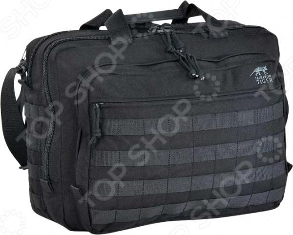 Сумка Tasmanian Tiger Document Bag это прочная, просторная и надежная дорожная мужская сумка. Она сделана из нейлона Cordura 700. В сумке есть вместительные боковые карманы и удобный ремень для переноски на плече. В данной модели также предусмотрено специальное мягкое отделение для ноутбука.