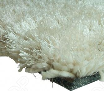 Ковер JAZZ прямоугольный, 70 140 см с длинным ворсом выполнен из хлопка и полиэстера песочного цвета. Ковер приятный на ощупь с длинным мягким ворсом. Фабричная обработка кромки ковра увеличивает срок службы изделия и улучшает его внешний вид. Ковер Vortex Jazz добавит тепла и уюта в ваш дом.