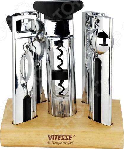 Набор кухонных принадлежностей Vitesse VS-1975 на удобной подставке из дерева пригодится на любой кухне. Предметы изготовлены из нержавеющей стали высокого качества. Состоит из:  Ключ консервный  Штопор  Пресс для чеснока  Открывалка для бутылок  Щипцы для колки орехов  Подставка