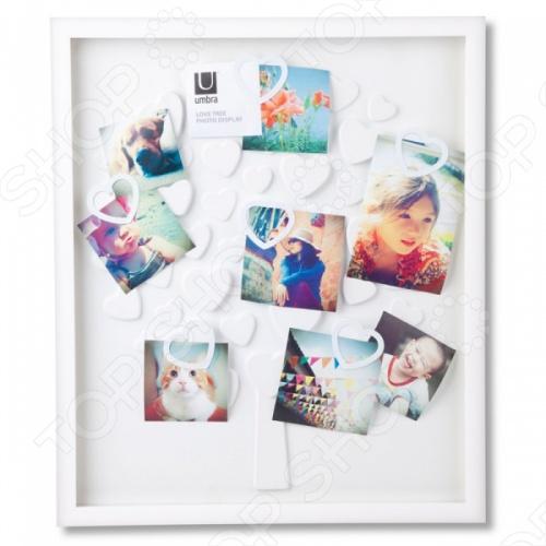 Рамка для фотографий Umbra LovetreeФоторамки. Держатели<br>Рамка для фотографий Umbra Lovetree это замечательная фоторамка для 30 фотографий фотографий. У каждого человека есть особые воспоминания запечатленные в фотографиях, показывающие самые интересные промежутки жизни и которые заслуживают оправы. Можно повесить до 30 различных фото, как разного изображения, так и разного качества и величины. Идеально для декорирования стены в любой комнате, прихожей или гостиной<br>