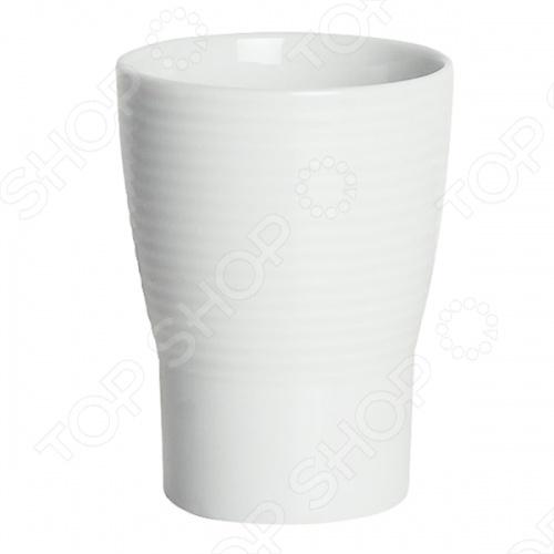 Стакан фарфоровый Spirella OPERAАксессуары для ванной комнаты<br>Стакан фарфоровый Spirella OPERA - это прекрасный аксессуар в вашу ванную комнату. Благодаря такой вещице зубные щетки всегда будут на месте в этом красивом и стильном стакане. Стакан выполнен из керамики. Керамика безопасна, надежна и долговечна, потому стакан сохранит свой внешний вид надолго. Кроме того, изделия из керамики смотрятся стильно и всегда на пике моды. Данная модель создаст особую атмосферу уюта и обеспечит максимальный комфорт в ванной комнате. Размер: 10,5 х 7,5 см.<br>