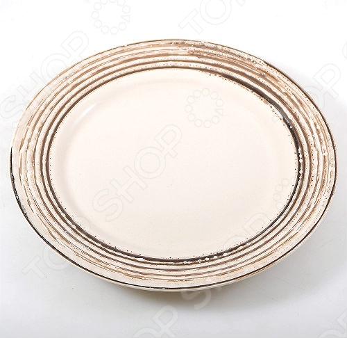 Тарелка из набора серии Томсон . Набор серии Томсон это сочетание эстетичности и функциональности. Посуда этой серии прекрасно впишется в интерьер вашей кухни. Диаметр тарелки 26 см.