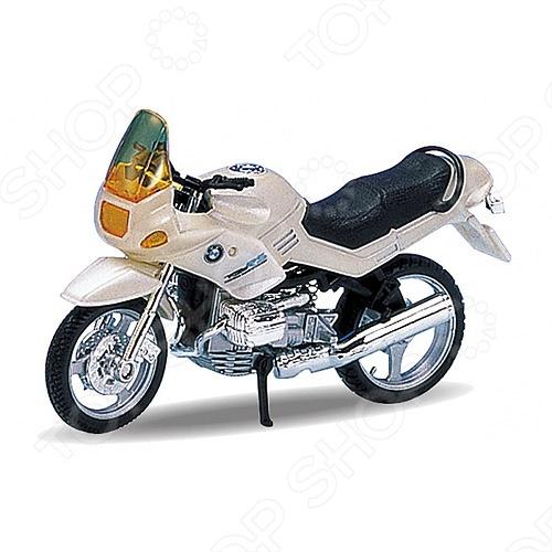Модель мотоцикла 1:18 Welly BMW R1100RS. В ассортиментеМодели авто<br>Модель 1:18 BMW R1100RS представляет собой точную копию настоящего мотоцикла. Коллекционная модель выпущена известной компанией по производству игрушек Welly. Особенность коллекции в том, что все модели изготовлены по лицензии именитых авто и мотопроизводителей. Мотоцикл изготовлен из металла с элементами пластика. У него вращаются колеса, поворачивается руль, подножка убирается. Модель 1:18 BMW R1100RS является отличным подарком не только ребенку, но и коллекционеру.<br>