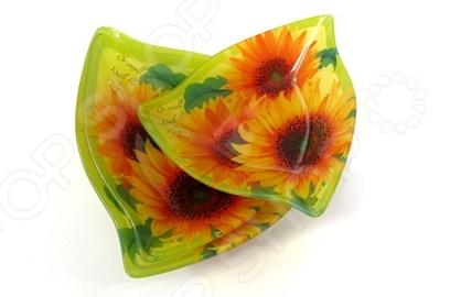 Набор салатников La Vita Солнечный день ZS-34-30 это объемные салатники с высококачественным покрытием, которые прекрасно подходят для подачи салатов на стол. Готовое блюдо получится не только вкусным и полезным, оно будет прекрасно выглядеть при подаче. Поверхность стеклянная, цвет изделия долго будет радовать вас, ведь он надежно защищен от повреждений. Размеры: 18 см, 20 см, 23 см.