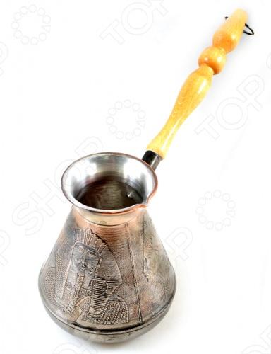 Турка медная Станица ЕгипетКофеварки. Кофемолки. Турки<br>Турка медная Станица Египет это отличная медная турка, которая выполнена из высокопрочного материала. Покрытие поможет увеличить срок службы турки и защищает рисунок. Интересный дизайн прибора отлично впишется в интерьер вашей кухни. Медные турки пользуются особой популярностью, ведь они представляют собой копии древних турок из восточных стран.<br>
