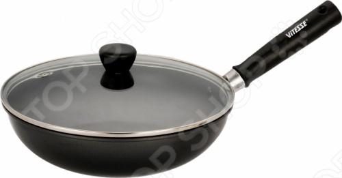 Сковорода вок Vitesse серии Classiс с крышкой изготовлена из углеродистой стали. Антипригарное покрытие Exdura Super. Утолщенное дно. Бакелитовая ненагревающаяся ручка. Крышка из термостойкого стекла. Можно мыть в посудомоечной машине.