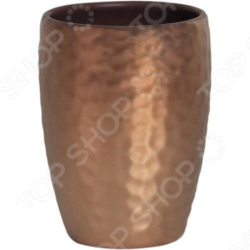 Стакан керамический Spirella Darwin hammeredАксессуары для ванной комнаты<br>Стакан керамический Spirella DARWIN HAMMERED - это прекрасный аксессуар в вашу ванную комнату. Благодаря такой вещице зубные щетки всегда будут на месте в этом красивом и стильном стакане. Стакан выполнен из керамики. Керамика безопасна, надежна и долговечна, потому стакан сохранит свой внешний вид надолго. Кроме того, изделия из керамики смотрятся стильно и всегда на пике моды. Данная модель создаст особую атмосферу уюта и обеспечит максимальный комфорт в ванной комнате. Размер - 8,0 x 11,0 см.<br>