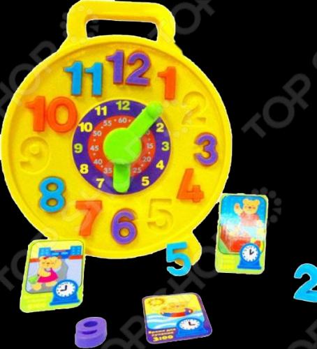 Игрушка развивающая Simba Часики отличный подарок для вашего малыша. Она поможет малышу научиться определять правильно время. При помощи колесика на циферблате стрелки могу вращаться. В комплект входят карточки с распорядком дня, которые будут привлекать внимание малыша. Выемки для цифр помогут ребенку быстрее выучить и запомнить числа. Игрушка развивающая Simba Часики станет любимой игрушкой вашего малыша.